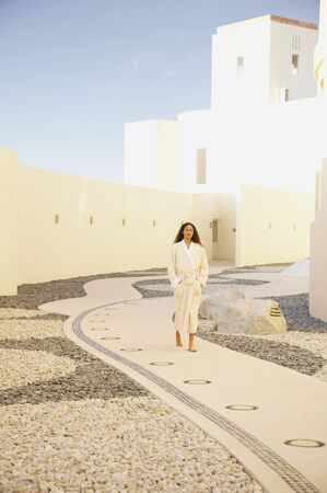 Woman in bathrobe outdoors at resort hotel, Los Cabos, Mexico Stock Photo - 16090998
