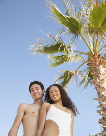 Couple in bathing suits smiling, Los Cabos, Mexico Stock Photo - 16091003