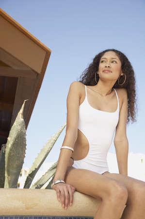 Hispanic woman in bathing suit sitting next to cactus, Los Cabos, Mexico Stock Photo - 16091004