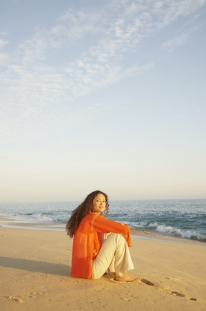 Woman sitting on the beach, Los Cabos, Mexico Stock Photo - 16091024