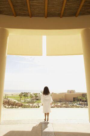 Woman in bathrobe outdoors at resort hotel, Los Cabos, Mexico