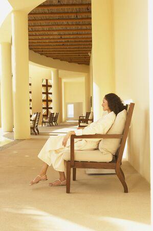 Woman in bathrobe sitting in resort hotel lobby Stock Photo - 16091041