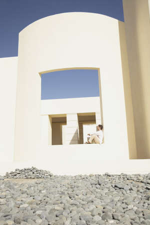 Man sitting in large open air window, Los Cabos, Mexico Stock Photo - 16091043