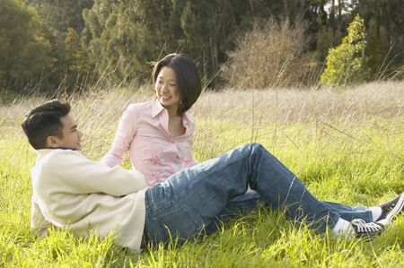 Young couple relaxing in the grass Stock Photo - 16091082