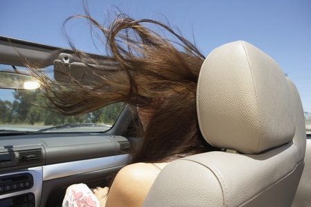 Young woman's hair being blown by wind