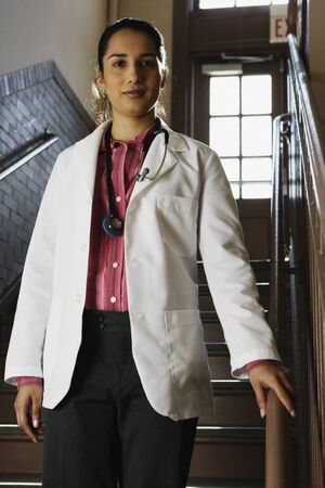stepping: Female doctor smiling for the camera LANG_EVOIMAGES