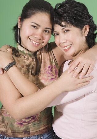 filipino ethnicity: Mother and daughter smiling for the camera