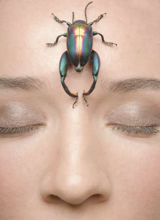 Young woman with a beetle on her forehead Stock Photo - 16091191