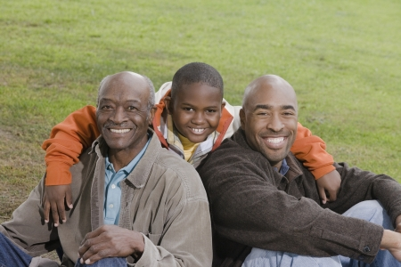grandfather and grandson: African American family smiling outdoors