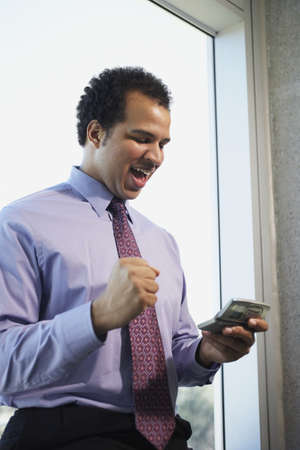 African American businessman using cell phone Stock Photo - 16091221
