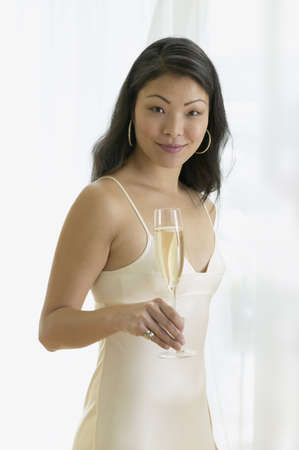 Asian woman holding glass of champagne Stock Photo - 16091251