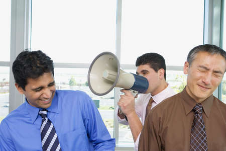 declaring: Group of businessmen with megaphone