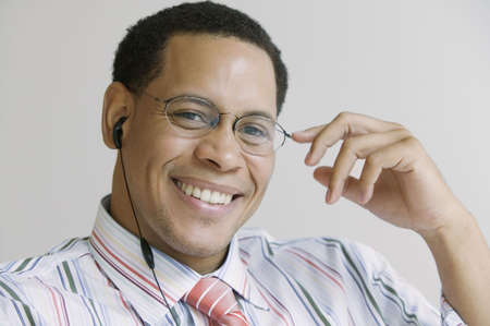 African American businessman with cell phone headset Stock Photo - 16091286