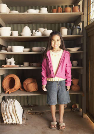 Hispanic girl in pottery shed Stock Photo - 16070327