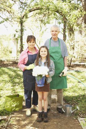 Hispanic grandparents and granddaughter gardening Stock Photo - 16091296