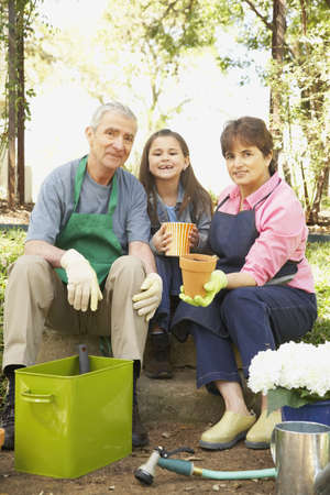 Hispanic grandparents and granddaughter gardening Stock Photo - 16091298