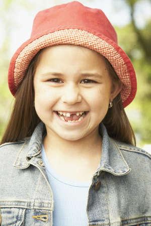 milepost: Close up of Hispanic girl smiling