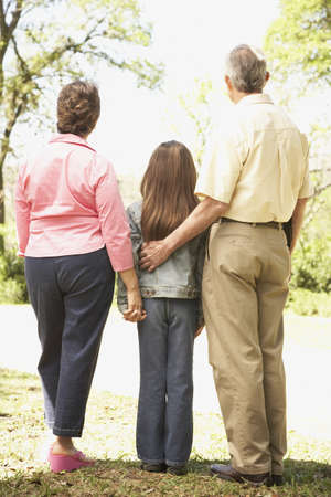 Rear view of Hispanic family outdoors Stock Photo - 16091304
