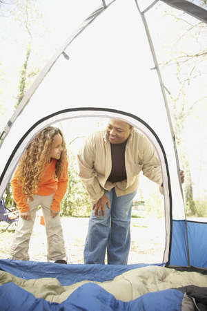 babyboomer: African American mother and daughter camping