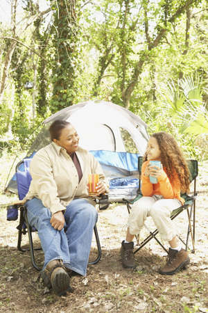 African American mother and daughter camping
