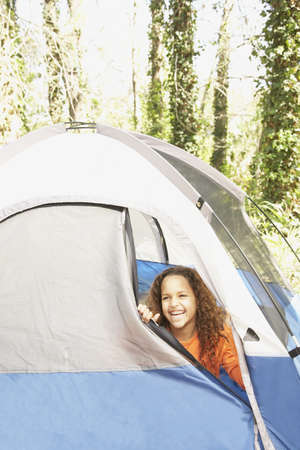 mischeif: African American girl peeking out of tent