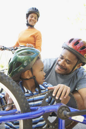 African American family fixing bicycle Stock Photo - 16091318