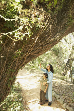 Hispanic mother and son on nature trail Stock Photo - 16091320