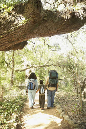 boomers: Hispanic family hiking with backpacks