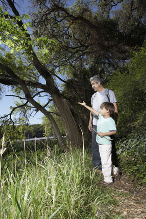 babyboomer: Father and son on nature walk