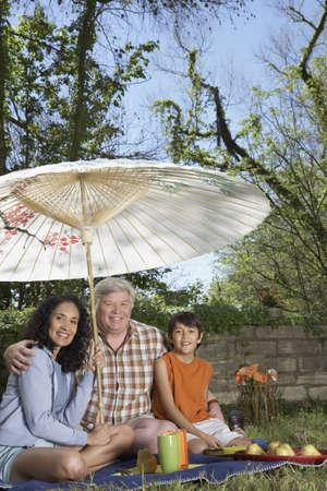 babyboomer: Hispanic grandparents and grandson having a picnic