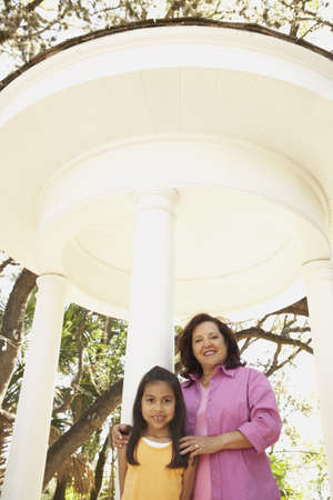 seventy two: Hispanic mother and daughter outdoors