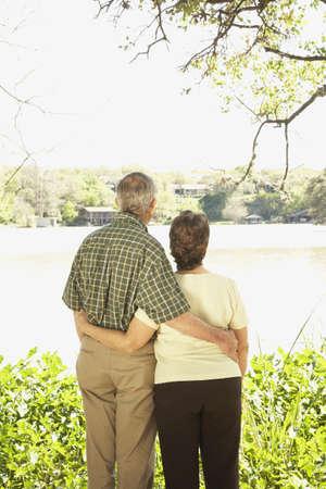 Rear view of senior Hispanic couple hugging outdoors Stock Photo - 16091367