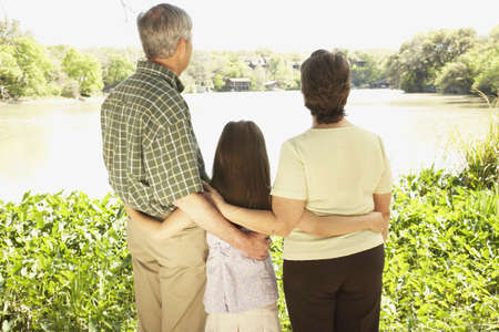 Rear view of Hispanic family outdoors Stock Photo - 16091369