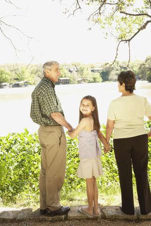 babyboomer: Hispanic girl with grandparents outdoors