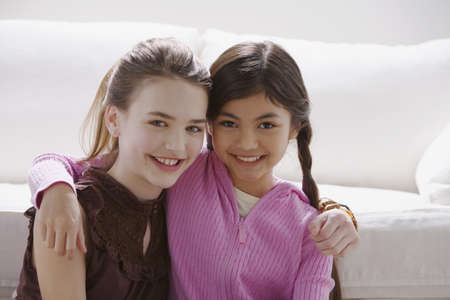 Two girls smiling and hugging Stock Photo - 16091381