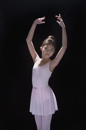 Studio shot of Hispanic girl in ballerina outfit