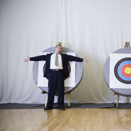Businessman standing in front of bulls eye Stock Photo - 16091447
