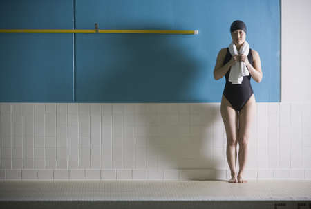 Female Asian swimmer with towel Stock Photo - 16070335