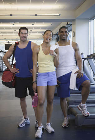 Three people at gym Stock Photo - 16091459