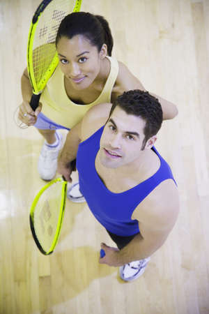 High angle view of man and woman with Squash rackets Stock Photo - 16091482