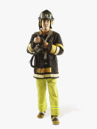 jeopardizing: Studio shot of male fire fighter LANG_EVOIMAGES