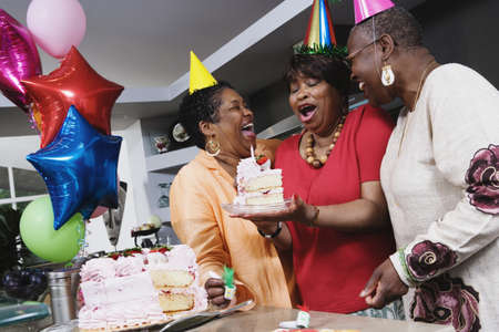 Three middle-aged African women at birthday party Stock Photo - 16091514
