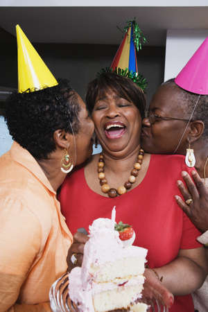 Three middle-aged African women at birthday party Stock Photo - 16091515