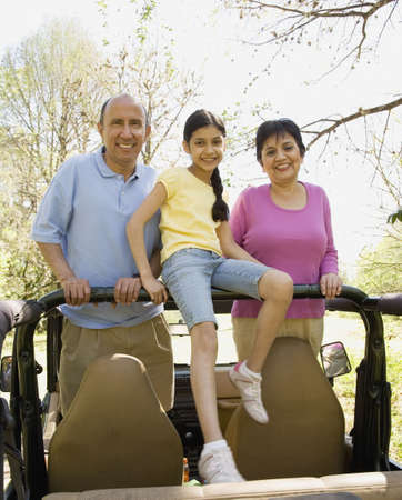Grandparents and granddaughter in jeep Stock Photo - 16091528