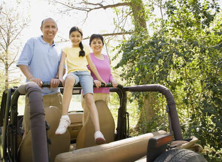 fathering: Grandparents and granddaughter in jeep