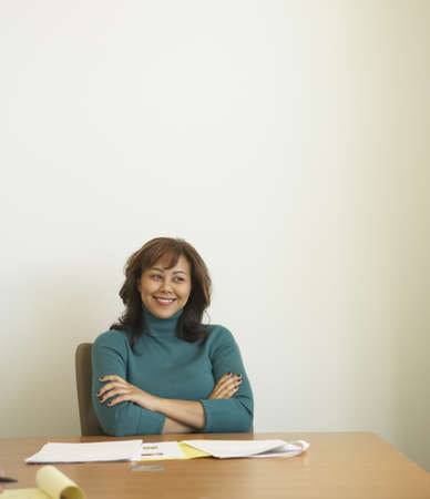 north western european descent: Businesswoman at conference table with paperwork