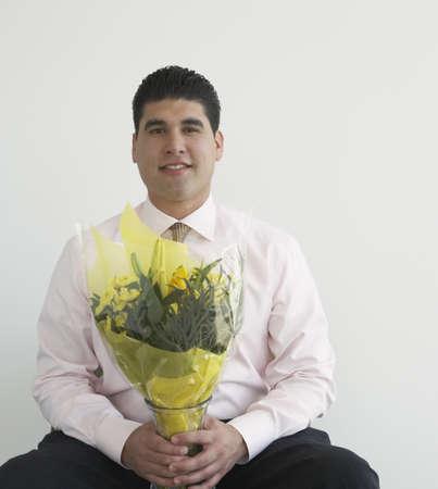 hilarity: Businessman holding bouquet of flowers