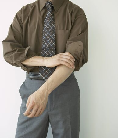 sleeve: Close up of businessman rolling up sleeves