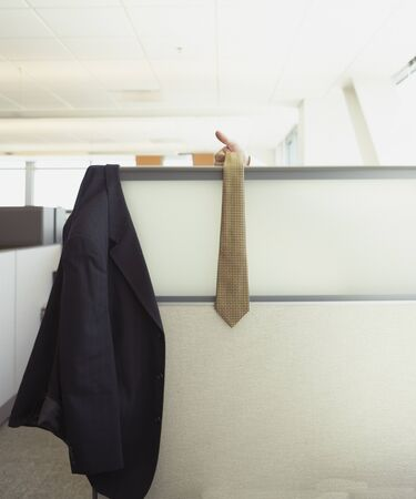 hilarity: Suit jacket and tie hanging over cubicle wall LANG_EVOIMAGES