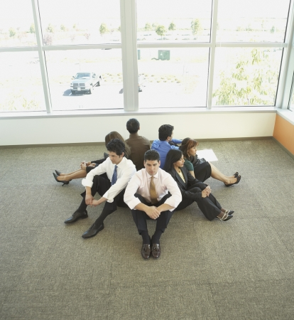 Businesspeople sitting back to back in circle Stock Photo - 16091554